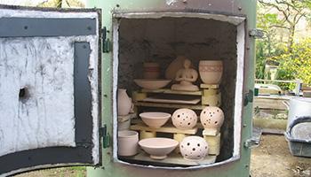 Enfournement pour une cuisson raku